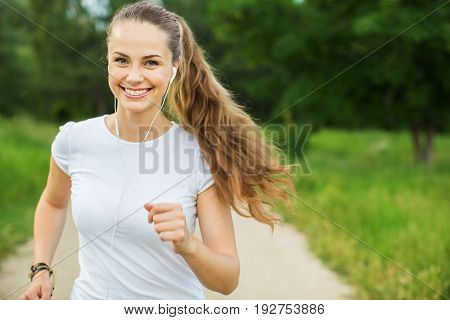 Beautiful young park woman run running sport