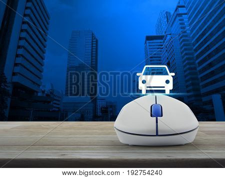 Car flat icon with wireless computer mouse over modern office city tower Internet transportation service concept