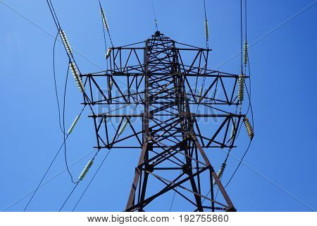 Electric pillar. Electric wires on a pillar in the city. High tension power line electrical wire. High voltage post. High-voltage tower background.