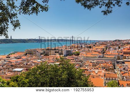 Aerial View Of Red Roofs Of Alfama And The River Tagus, Lisbon, Portugal