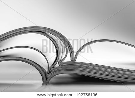 Open pile magazines black and white table image group