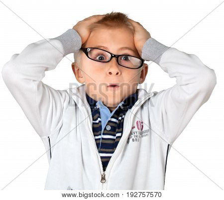 Little boy glasses amazed facial expression arms outstretched hands on head