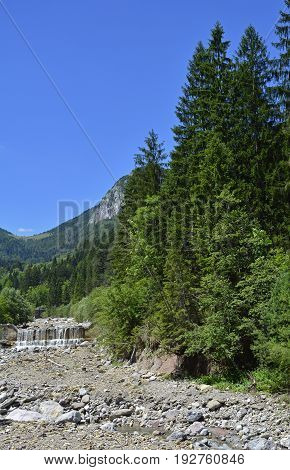 The mid-June rural landscape of the Carnic Alps near Pontebba Friuli Venezie Giulia north east Italy. poster