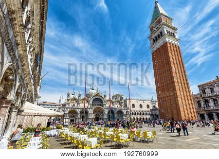 Venice, Italy - May 20, 2017: Piazza San Marco or St Mark's Square. Basilica and Campanile di San Marco in the center. This is the main square of Venice.