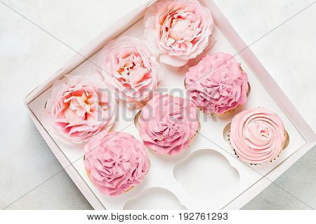 Pink cupcakes with roses in box. Festive and bright. Wedding Celebration concept