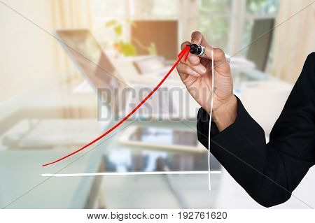 Double exposure of business man writing growth trend