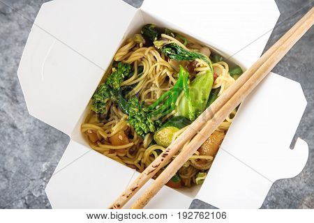 Chinese Noodles With Vegetables. Melon, Onion, Beans, Broccoli.