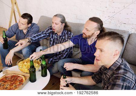 Friends Watching Loosing Football Match