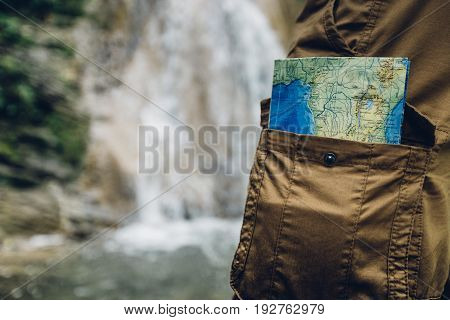 Unrecognizable Man Standing With Travel Map In Pocket Closeup Hiking Travel Tourism Concept Selective Focus