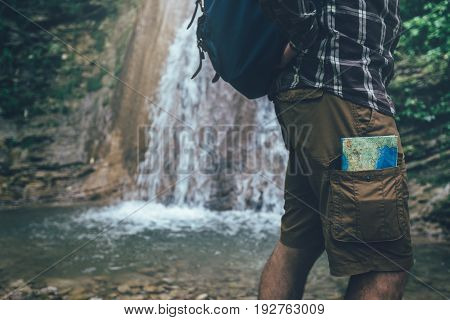 Unrecognizable Hiker Standing With Travel Map In Pocket Hiking Travel Tourism Concept Selective Focus