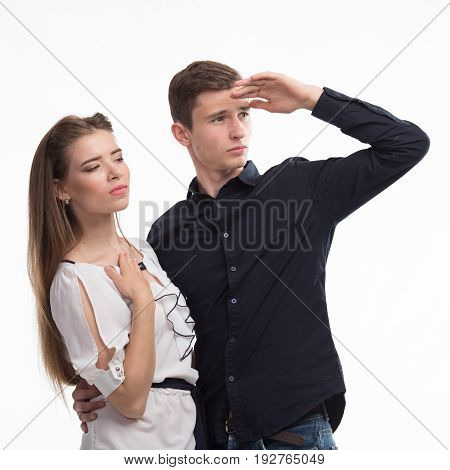 Young pensive couple portrait of a confident businessman showing presentation, gray background. Ideal for banners, registration forms, presentation, landings, presenting concept.
