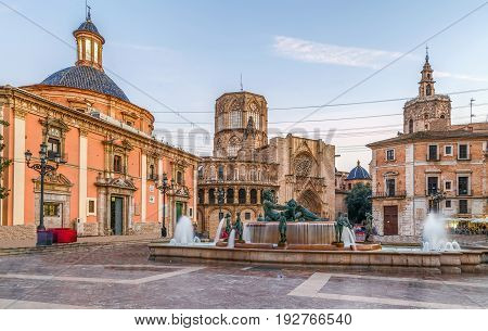 Virgen square with cathedral and Turia Fountain in Valencia Spain