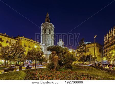 View of Valencia Cathedral or Basilica of the Assumption of Our Lady of Valencia from Plaza de la Reina in evening Spain