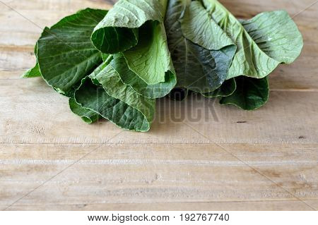 choy sum vegetable on wooden table background