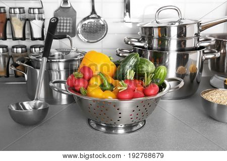 Utensils and vegetables for cooking classes on table in kitchen