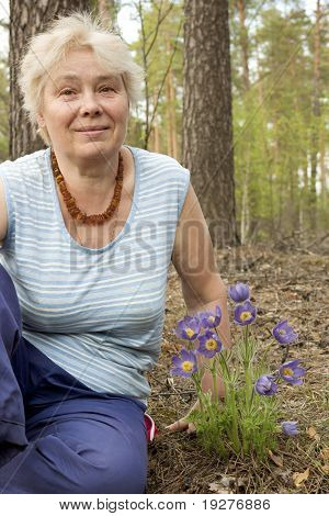 An Elderly Woman In The Forest Springtime