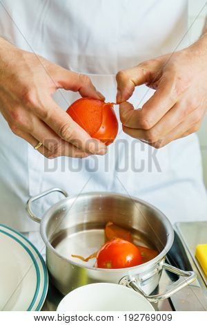 chef peeling tomato