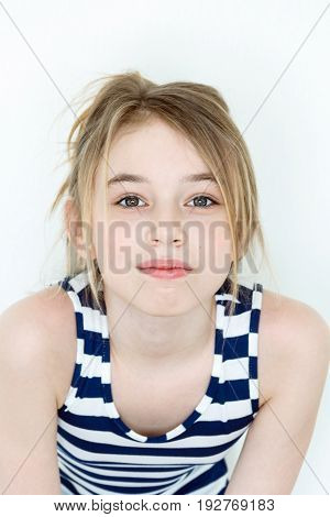 Close portrait of girl eleven years old with big green eyes on white