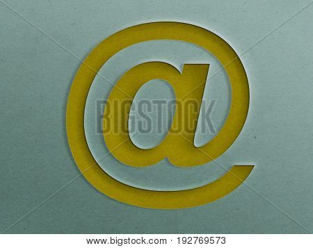 Yellow Paper Cut out at @ Sign on the Grunge Paper