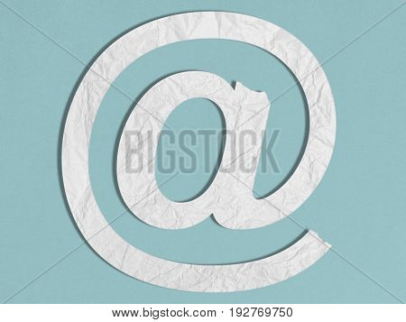 White Paper At @ Sign on Blue Background