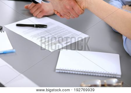 Business people shaking hands , finishing up a meeting to sign a new contract.