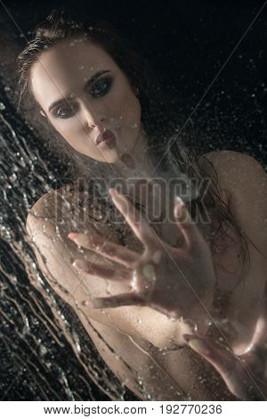 Gorgeous longhaired brunette shot nude in studio aquazone