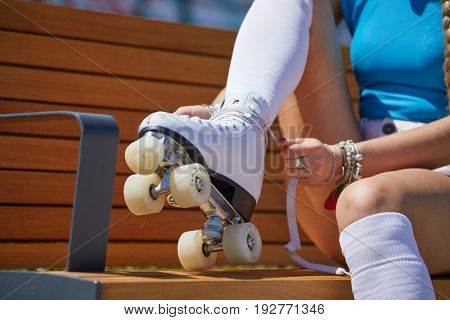 The girl assumes roller skates