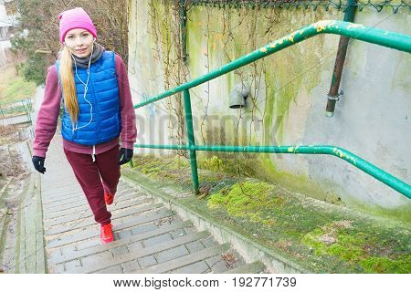 Outdoor sport exercises sporty outfit ideas. Woman wearing warm sportswear training exercising outside during autumn.