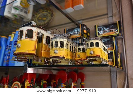 Sintra Portugal - June 07 2017: Street shop with models vintage yellow trams as souvenirs. Very popular purchases by tourists in Portulal