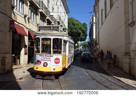 Lisbon Street Scene With Old Tram