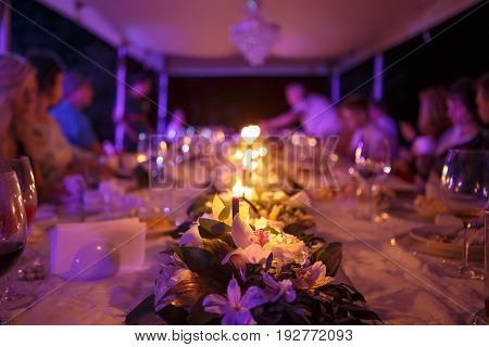 table for a wedding reception with candles on the nature in the evening