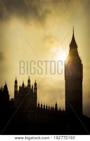 The Houses of Parliament and Big Ben silhouetted against sun