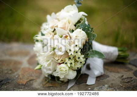 Beautiful wedding bouquet of white roses and hydrangeas