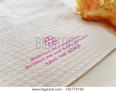 brown tissue paper recycle on table with piece of donut