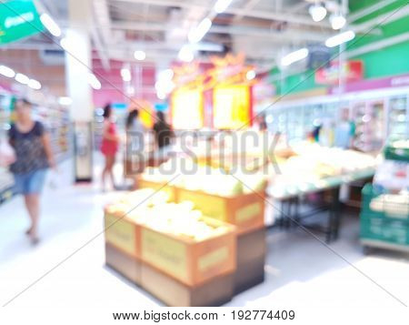 Abstract blurred supermarket aisle with unrecognizable customers in Thailand
