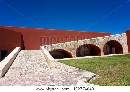 Defensive wall now painted red in Campeche Mexico
