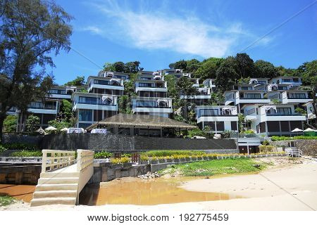 A luxurious hotel by the sea and sewerage flowing to the beach. Conceptual contrast. Ecological disaster