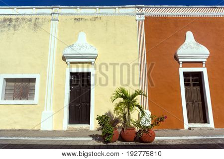 View of two different color historic buildings in Valladolid Mexico