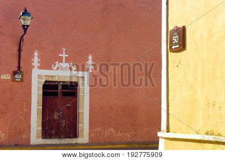 Red and yellow colonial architecture in Valladolid Mexico