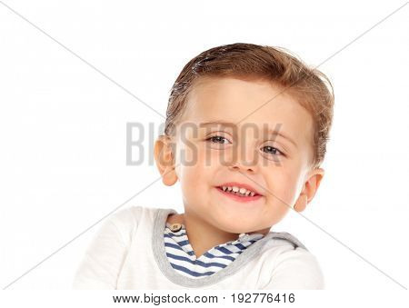 Beautiful little child two years old with blond hair isolated on a white background