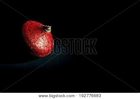 christmas red ball on black background. Uncluttered style
