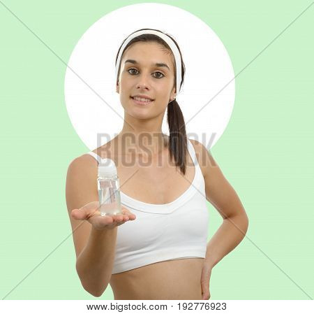 a smiling young beautiful woman showing antiperspirant deodorant