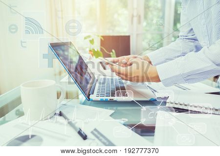 Business Man Holding Smart Phone During Working At Home Office