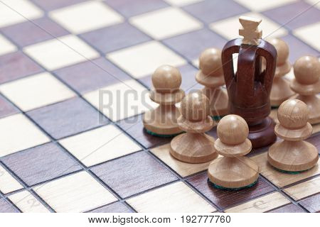 Business concept of win or defeat loss end of the game. Chessboard and figures of the fail king and pawns.