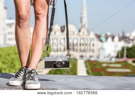 Woman standing with photocamera on the famous Arts mountain with great view on the old city in Brussels
