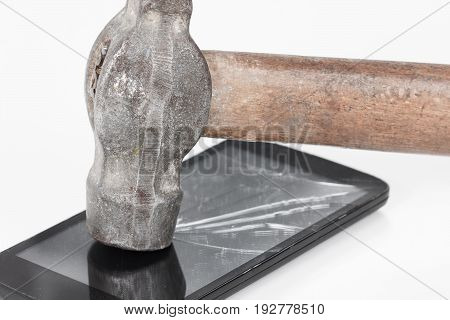 Crack glass display of the smartphone or a tablet the result of falling hitting or damaging the hammer.
