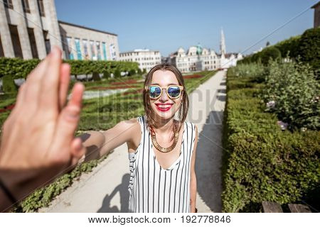 Young businesswoman giving a five standing on the arts mountain in Brussels