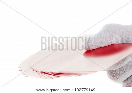 Playing cards game poker hand with glove isolated on white background. Casino games collection