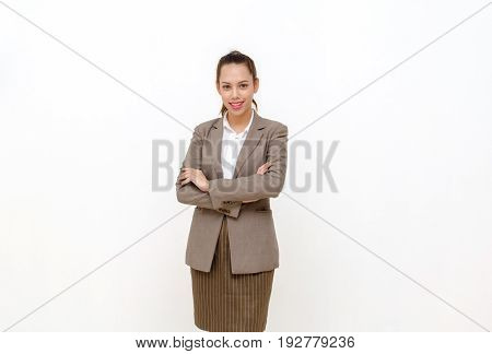 beautiful asian young business woman smiling in suit standing and crossed arms isolated on white background
