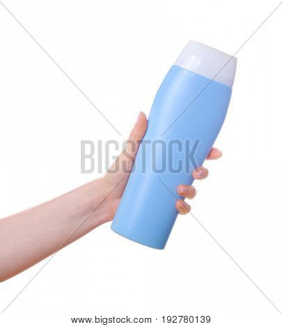 Female hand with bottle of cosmetic product for shower on white background